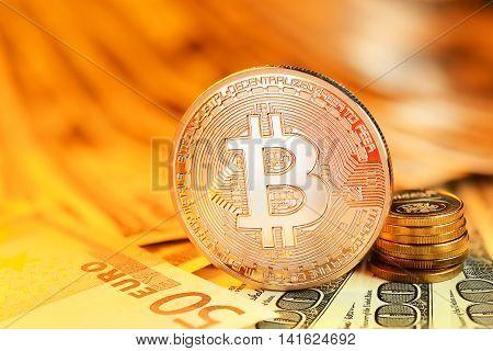 Golden Bitcoin And Banknotes