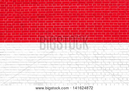 Flag of Indonesia Monaco Hesse on brick wall texture background. Indonesian national flag.