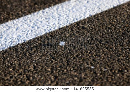 glass left on the pavement after the commission of a road accident, a new road in black, defocused
