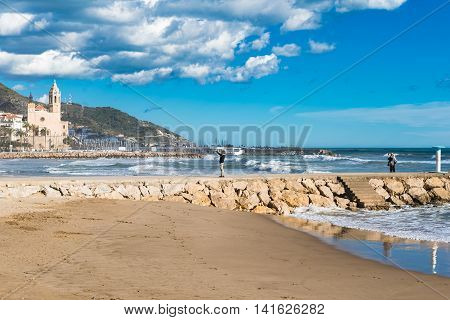 People At Beach In Sitges, Spain