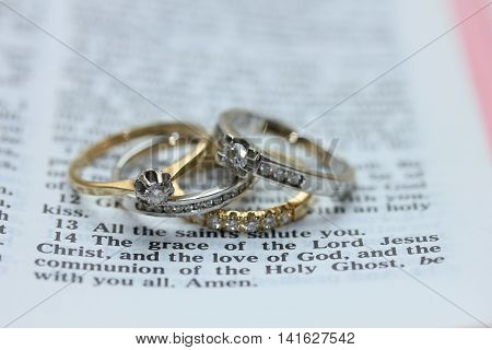 Two wedding sets one in yellow gold one in white gold for a double bride wedding on a bible verse