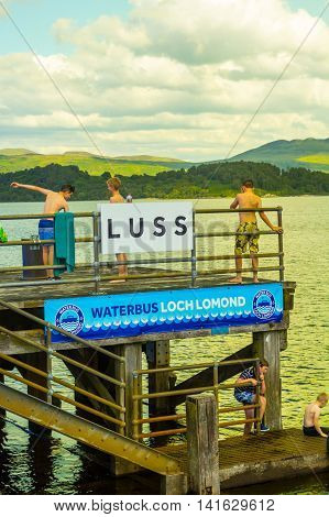 Children having fun on a sunny day at the Luss Pier Loch Lomond Argylle and bute Scotland, 21 July 2016