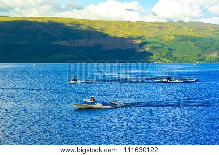 People on the motor boat at the Loch Lomond lake in Scotland, 21 July 2016