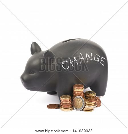 Word Change written with chalk on a black ceramic piggy bank coin container next to a pile of euro coins, composition isolated over the white background