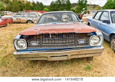 Rusting Car In Junk Yard