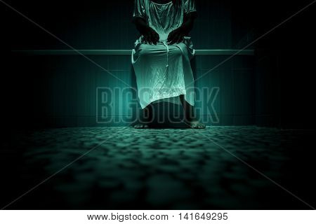 Scary person in white dress sitting on bathtub,Scary background for book cover