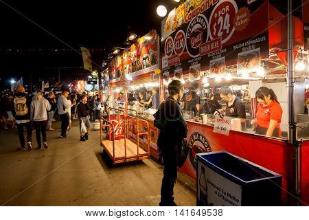 RICHMOND CANADA - JULY 10: Visitors at the Richmond night market near Vancouver enjoying food and fun July 10 2016. The market attracts visitors from around the world for its ethnic food unique shops and nightly street entertainment.