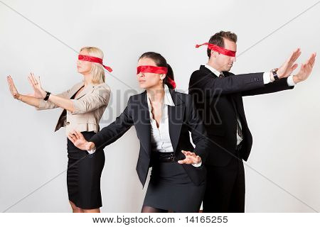 Group of disoriented businesspeople