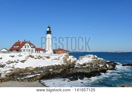 Portland Head Lighthouse and keepers' house in winter, Cape Elizabeth, Maine, USA