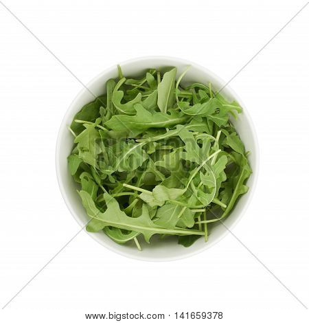 Ceramic bowl full of rocket salad leaves isolated over the white background, top view above