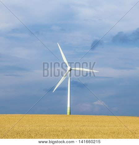 wind generator in rural landscape for sustainable energy