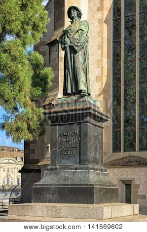 Zurich, Switzerland - 30 July, 2016: statue of Ulrich Zwingli at the Water Church. The bronze statue by sculptor Heinrich Natter was unveiled in 1885.