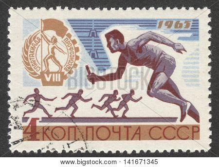 MOSCOW RUSSIA - CIRCA APRIL 2016: a post stamp printed in the USSR shows a runner the series