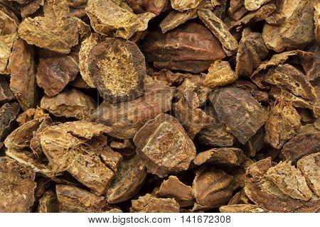 Organic cracked Chebulic Myrobalan or Choti Harad (Terminalia chebula). Macro closeup background texture. Top View.