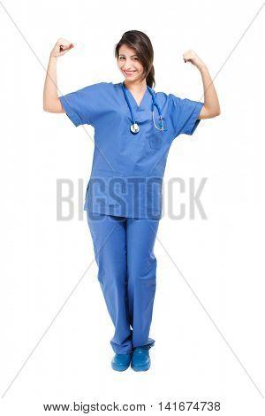 Young nurse flexing biceps
