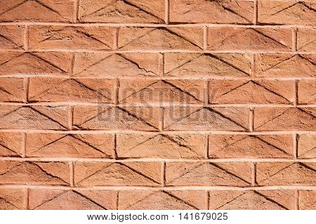Orange angular brick wall with triangle shapes