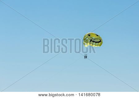 Parasailing on a yellow parachute over water Fort Myers. Florida