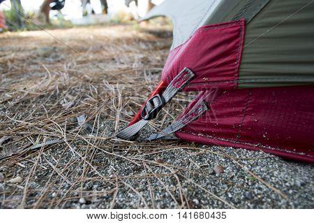 Carbine on a camp tent closeup blue