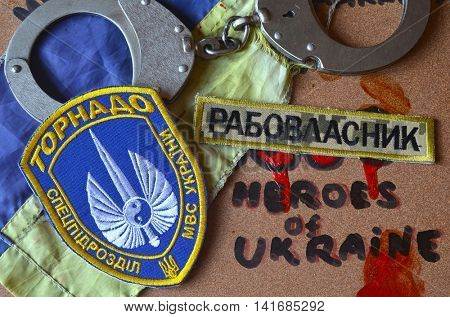 ILLUSTRATIVE EDITORIAL.Chevron of Ukrainian SPECIAL chastener battalion Tornado in Police.The battalion disbanded for pederastic rapes kids,marauding and torture.August 7 ,2016 in Kiev, Ukraine