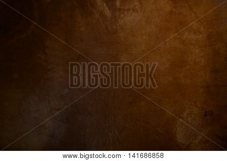 Old rustic dark brown leather background texture