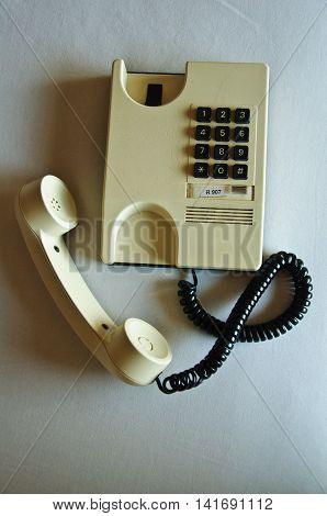 Office telephone set off hook, business concept
