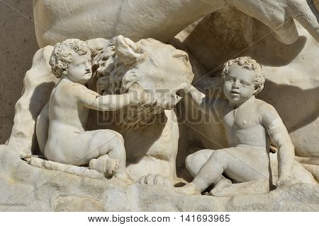 The legendary Capitoline She-Wolf with Twins Romulus and Remus symbolizes the Founding of Rome. An ancient roman sculpture in Capitol Hill Square.