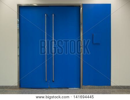 Front view of a modern blue door