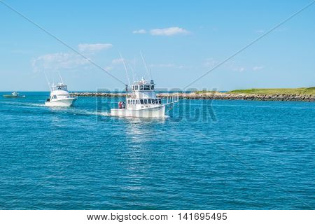 MONTAUK, LONG ISLAND, US, JUNE 18, 2016: Fishing charter boats come back from sea