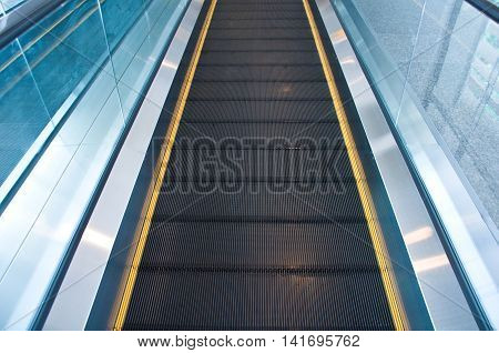Moving escalator in an airport, empty escalator
