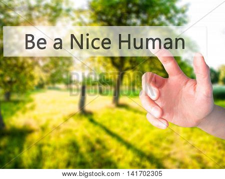 Be A Nice Human - Hand Pressing A Button On Blurred Background Concept On Visual Screen.