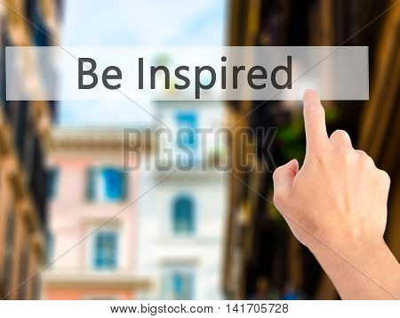 Be Inspired - Hand Pressing A Button On Blurred Background Concept On Visual Screen.