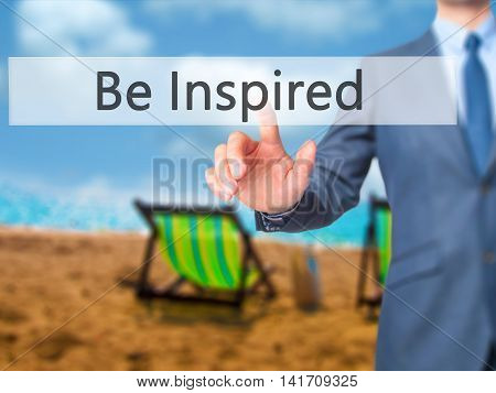 Be Inspired - Businessman Hand Pressing Button On Touch Screen Interface.