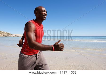 Happy Young Black Man Walking Along The Seashore
