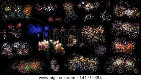 Colorful holiday fireworks set over black sky background