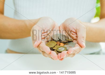 Handful Of Coins In Palm Hands,businessman Holding Plant Sprouting From A Handful Of Coins,finance C
