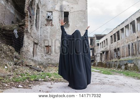 Desperate Syrian woman in destroyed city poster
