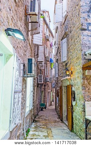 The narrow backstreet of the old town is full of the souvenir stalls tiny bars and workshops Budva Montenegro.