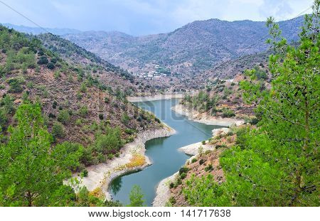 The Palaichori dam among the pines in Troodos mountains Nicosia District Cyprus.