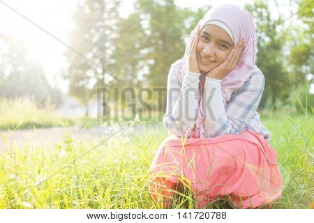 Beautiful Muslim Arab girl happy in nature