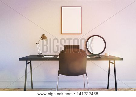 Workplace in modern home office. Table and chair near white wall. Mirror laptop and lamp on desk. Poster on wall. 3d rendering. Mock up. Toned image