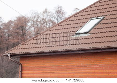 Stone Coated Metal tile Roof with skylights and rain gutter