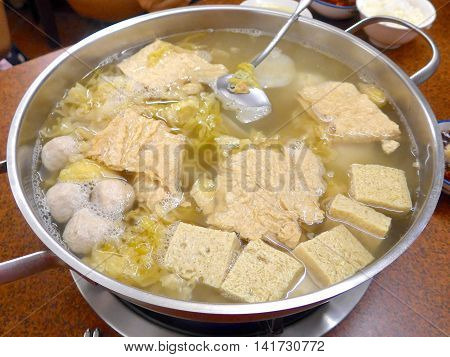 Streaky pork with pickled cabbage and meat balls hot pot