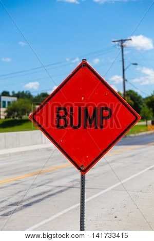 A bump hazard sign warning there is a bump in the roadway.
