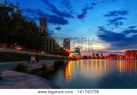 night over the city center and a summer pond Yekaterinburg
