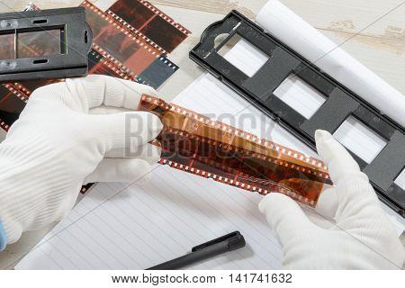 a technician scan a  negative color  film