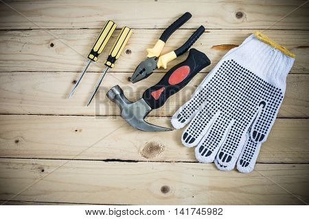 Tools And Gloves On Wooden Table