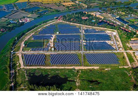 Solar farm solar panels aerial photo from the air outside the Bangkok Thailand