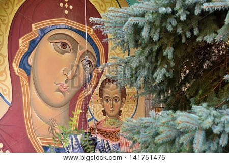 Madonna with Jesus Child a fresco on the wall of Paraskeva Church. St. Paraskeva-Pyatnitsa monastery. Built in 1867. Masterpiece of old russian ortodox art. Eclecticism architecture in Dedilovo village founded in 1146 central region of Russia