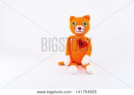 Broken heart with scar, stuffed toy cat. Horizontal isolated on white.
