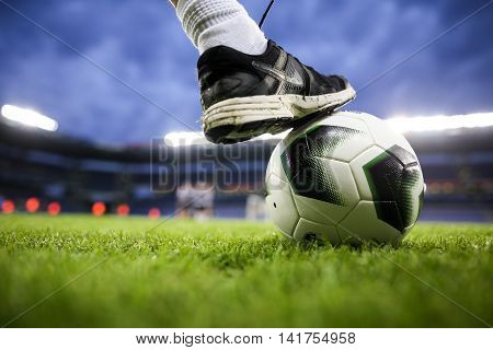 Copenhagen Denmark - August 26 2015: Close up of feet and the ball during the training of PAOK players before the game against Brondby. Selective focus image with shallow depth of field
